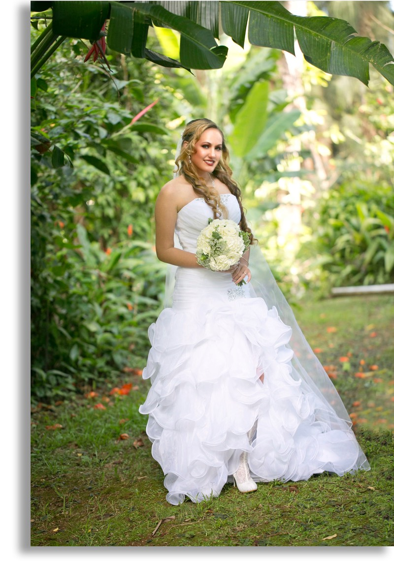 Gorgeous young bride poses after Kauai ceremony. Photographer Difraser