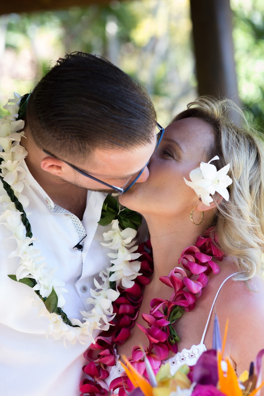 Big wet kiss bride and groom Kauai wedding