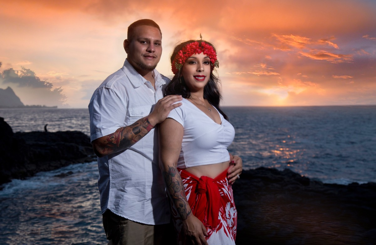 Flaming red sky sunset with bridal couple Kauai