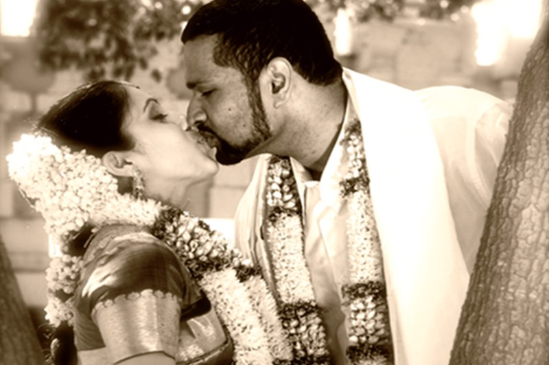 Indian couple kiss after the wedding ceremony, Kauai