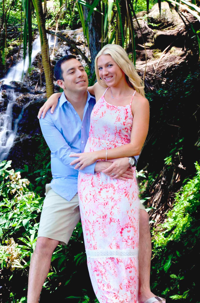 newlyweds by waterfall at Queen's Bath, Kauai wedding photographer Difraser.